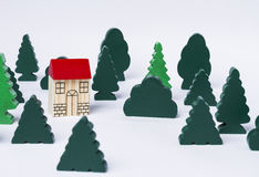 Toy house in forest Stock Images