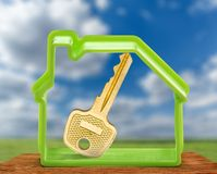 Toy house form and key as symbol Stock Photo