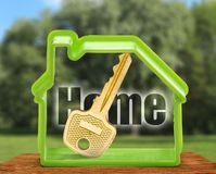 Toy house form and key as symbol Royalty Free Stock Photo