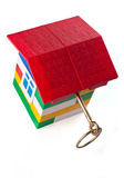 Toy house with golden key Royalty Free Stock Images