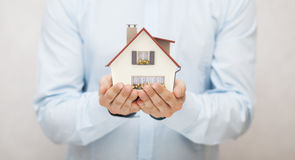Toy house in hands Stock Image