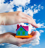 Toy house in human hands Royalty Free Stock Photos