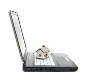 Toy House on laptop Royalty Free Stock Photos