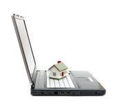 Toy House on laptop Royalty Free Stock Photos