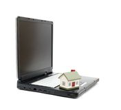 Toy House on laptop Royalty Free Stock Photography