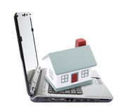 Toy house on laptop Stock Photography