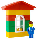 Toy house and little man Royalty Free Stock Image