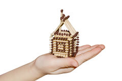 Toy house made of matches on a white background Royalty Free Stock Images