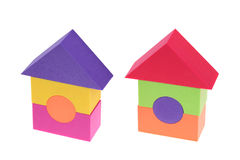 Toy house made of plastic bricks. On white background Stock Photography