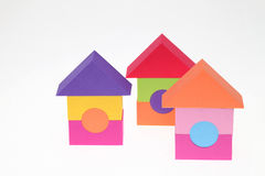 Toy house made of plastic bricks. On white background Royalty Free Stock Photography