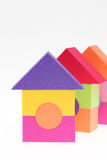 Toy house made of plastic bricks. On white background Royalty Free Stock Photos