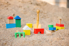 Toy house made of wooden blocks in sandbox Stock Images