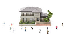 Toy house and miniature people Stock Images