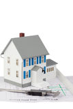 Toy house model and caliper on a ground floor plan Royalty Free Stock Image