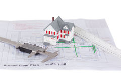 Toy house model and ruler and on a plan Royalty Free Stock Images