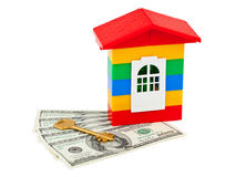 Toy house and money Royalty Free Stock Image