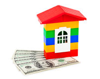 Toy house and money Stock Photos