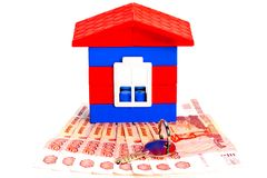 Toy house out of blocks is on the banknotes Stock Photos