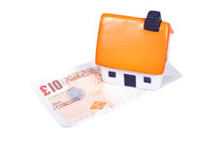 Toy house over banknote Royalty Free Stock Photography