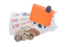 Toy house over cash money Royalty Free Stock Photo