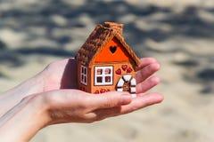 Toy house. Palm carefully holding toy house Royalty Free Stock Photos