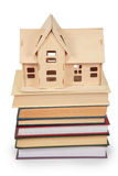 Toy house on pile of books Stock Image