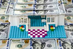 Toy house with a roof of dollars royalty free stock photos