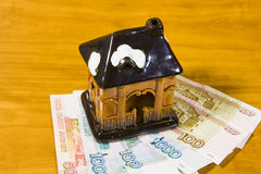 A toy house and Russian money Royalty Free Stock Image