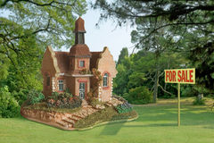Toy - house for sale. On lawn Stock Photos