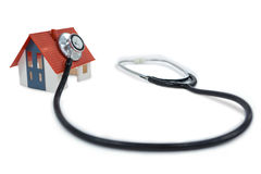 Toy house with stethoscope Stock Photos