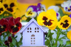 Toy house with a sun on a beautiful background. Symbol of happiness, Royalty Free Stock Photo
