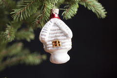 Toy house to decorate a Christmas tree. Stock Photo