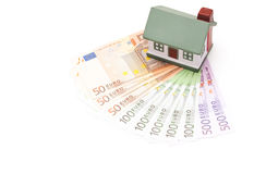 Toy house on top of european banknotes Royalty Free Stock Image