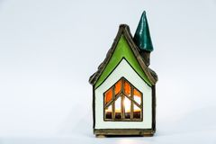 Toy house on a white background decorated for Christmas stock photography