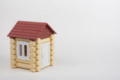 Toy house on white background, near a place under an inscription Stock Images