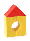 Toy house from wooden cubes Stock Photos