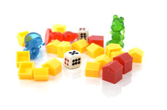 Toy houses puppets and dice on a white background Royalty Free Stock Photo