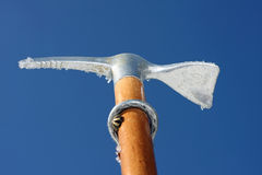 Toy ice axe and blue sky Stock Photography