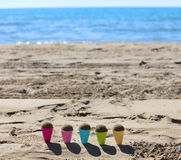 toy ice cream cones on the beach with sand Royalty Free Stock Image