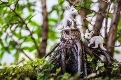 Toy kangaroo on stump. Baby toy kangaroos standing on tree stump Stock Photography