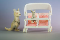 Toy kangaroos with baby chair Royalty Free Stock Images