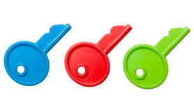Toy Keys. Three isolated toy keys in red, blue and green Stock Images