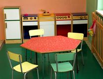 Toy kitchen and chairs to play in a nursery Stock Images