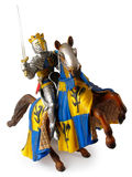 Toy knight. Small plastic toy, king in armor on a horse Stock Photography