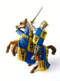 Toy knight. Small plastic toy, king in armor on a horse Stock Images