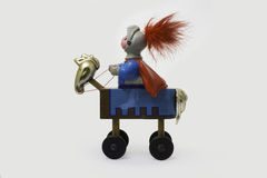 Toy knight on horse. Retro toy knight on wheel horse Royalty Free Stock Image