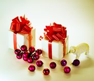 Toy lamb with Christmas balls. And fir paws gifts stock image