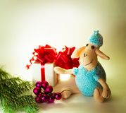Toy lamb with Christmas balls. And fir paws gifts royalty free stock photos