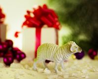 Toy lamb with Christmas balls Stock Images