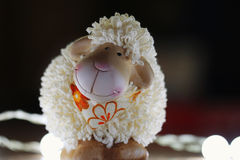 Toy lamb. On dark background royalty free stock images